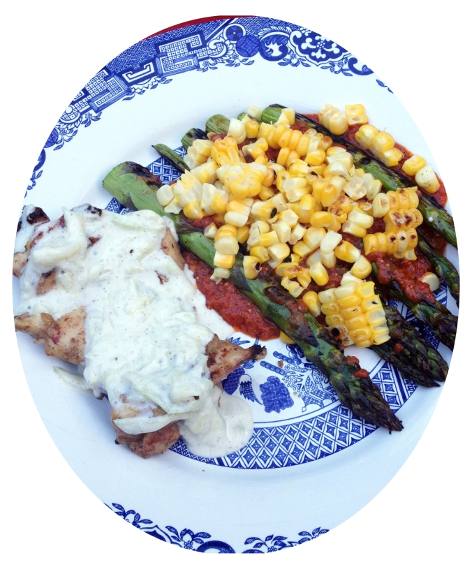 Left: Chicken marinated in a Cumin/Yogurt/Tamarind mixture, topped with Cucumber Raita Right: Grilled Asparagus and Corn on a Tomato Fenugreek curry