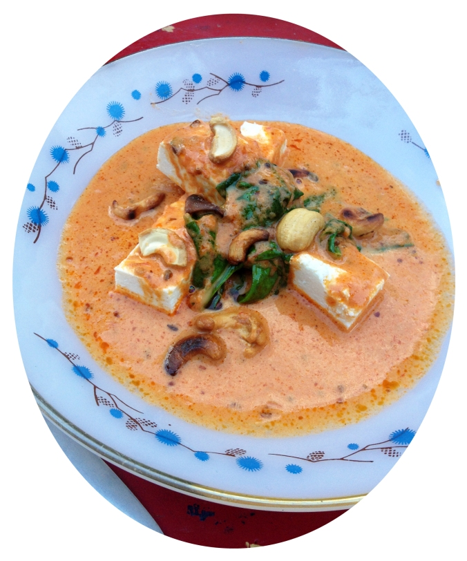 The paneer in the Cumin-centric Tomato & Coconut Curry with Wilted Arugula and cashews